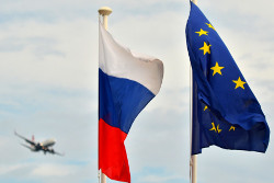 2481135 08/20/2014 Flags of Russia, the EU, France on the promenade of Nice. In background: a plane heading in for landing at Nice's international airport. Vladimir Sergeev/Sputnik
